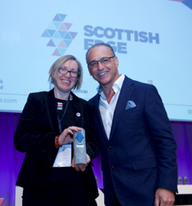 Founder Alison Gray with Scottish Edge panellist Theo Paphitis after winning funding at the Scottish Edge Awards